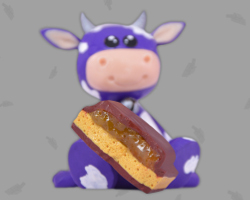 Picture of polymer clay caramel chocolate with purple cow. Created by Veronika Vetter German Fine Artist